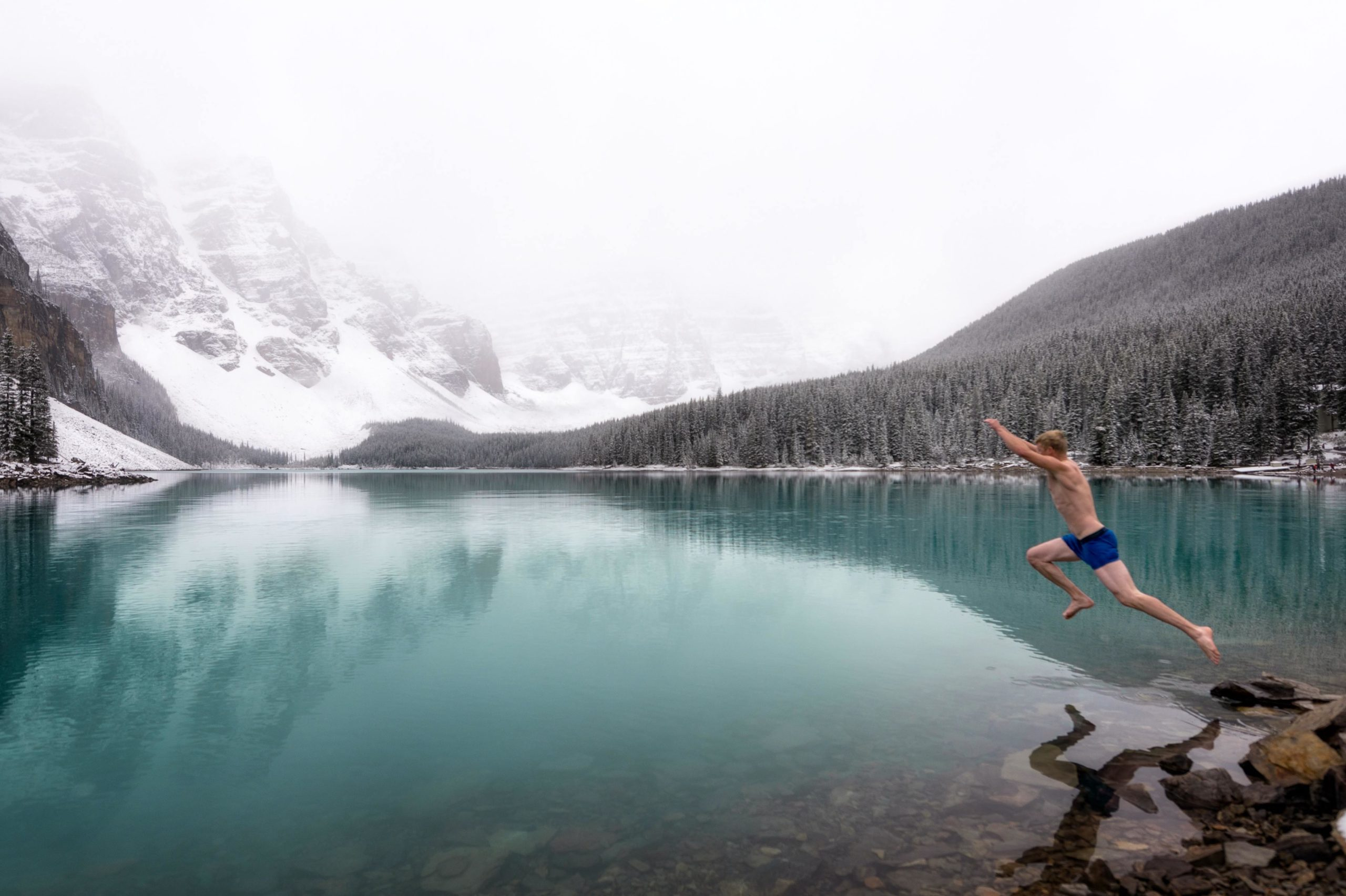 Shirtless Man Jumping into Cold Water