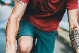 Man Biking Outside with Visible Arm Veins