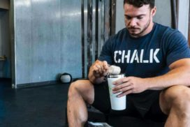 Man Adding Supplement to Shaker at Gym