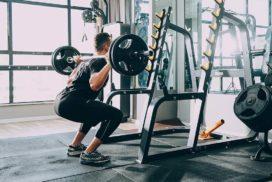 Man Doing Squats at a Gym