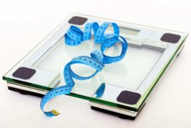 Weight Scale with Tape Measure on top of It