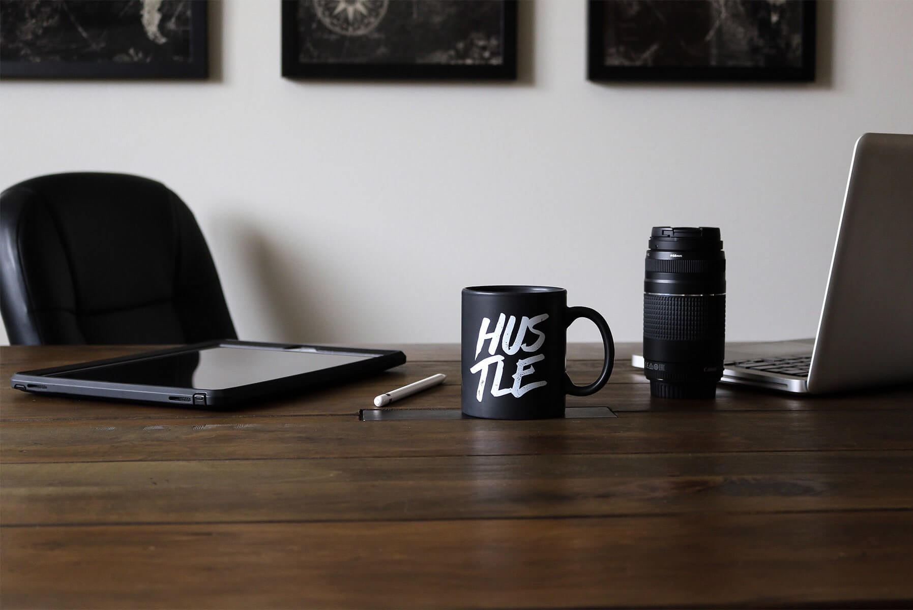 Desk with Laptop and Mug That Says Hustle