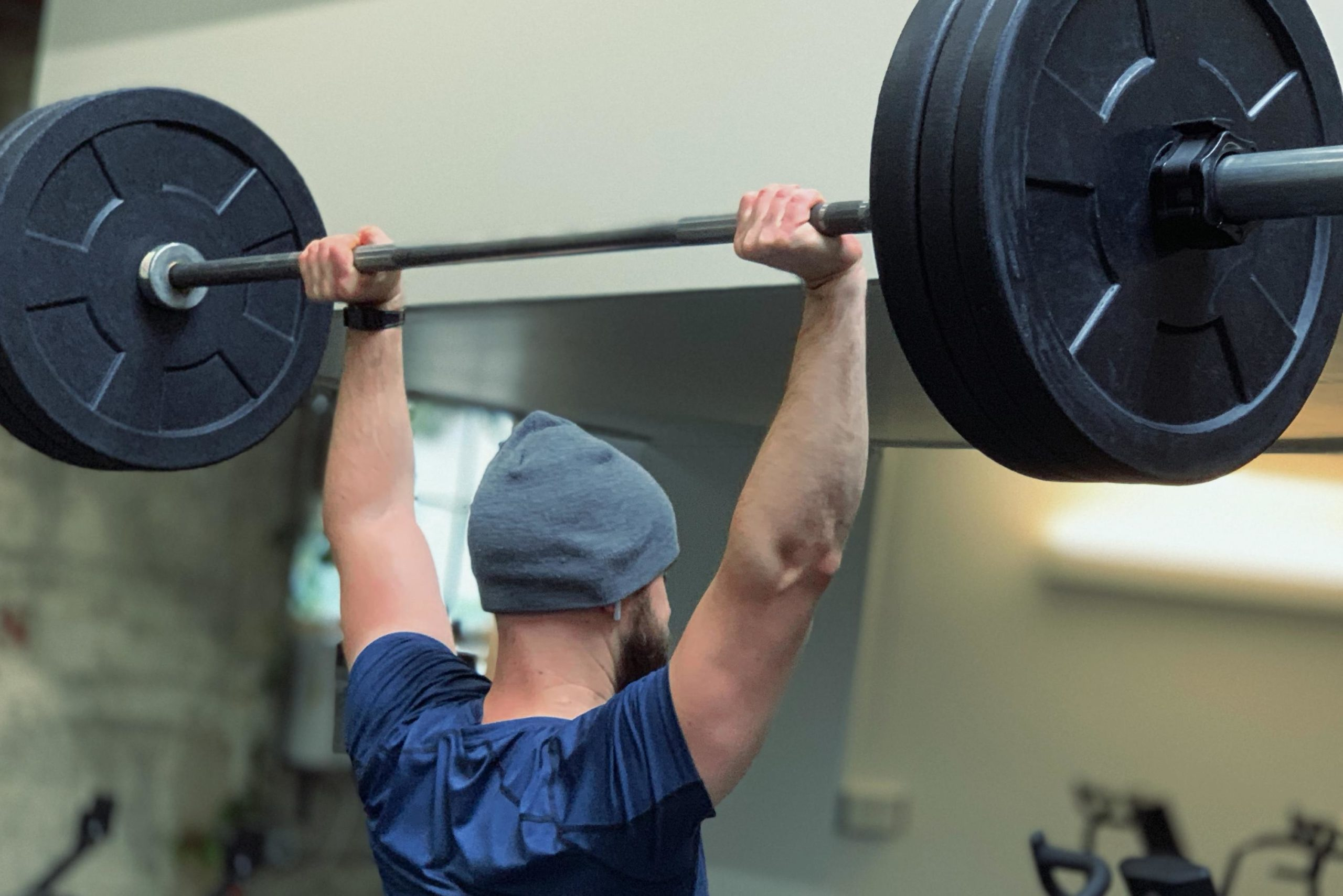 Man Weightlifting at a Gym