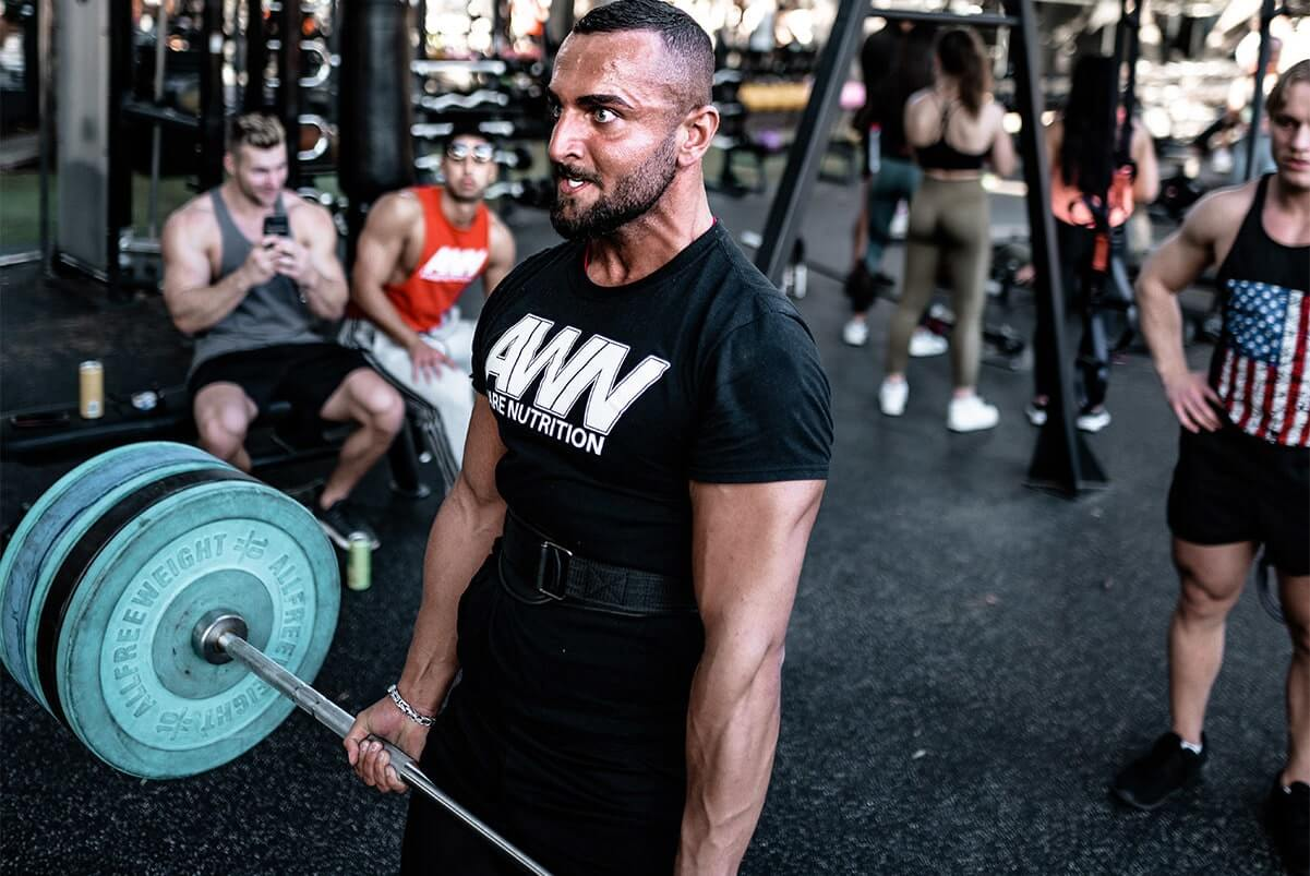 Man Doing Deadlifts at a Gym