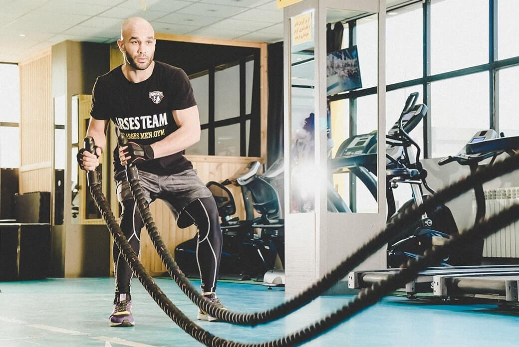 Man Doing Cardio at Gym with Mouth Closed