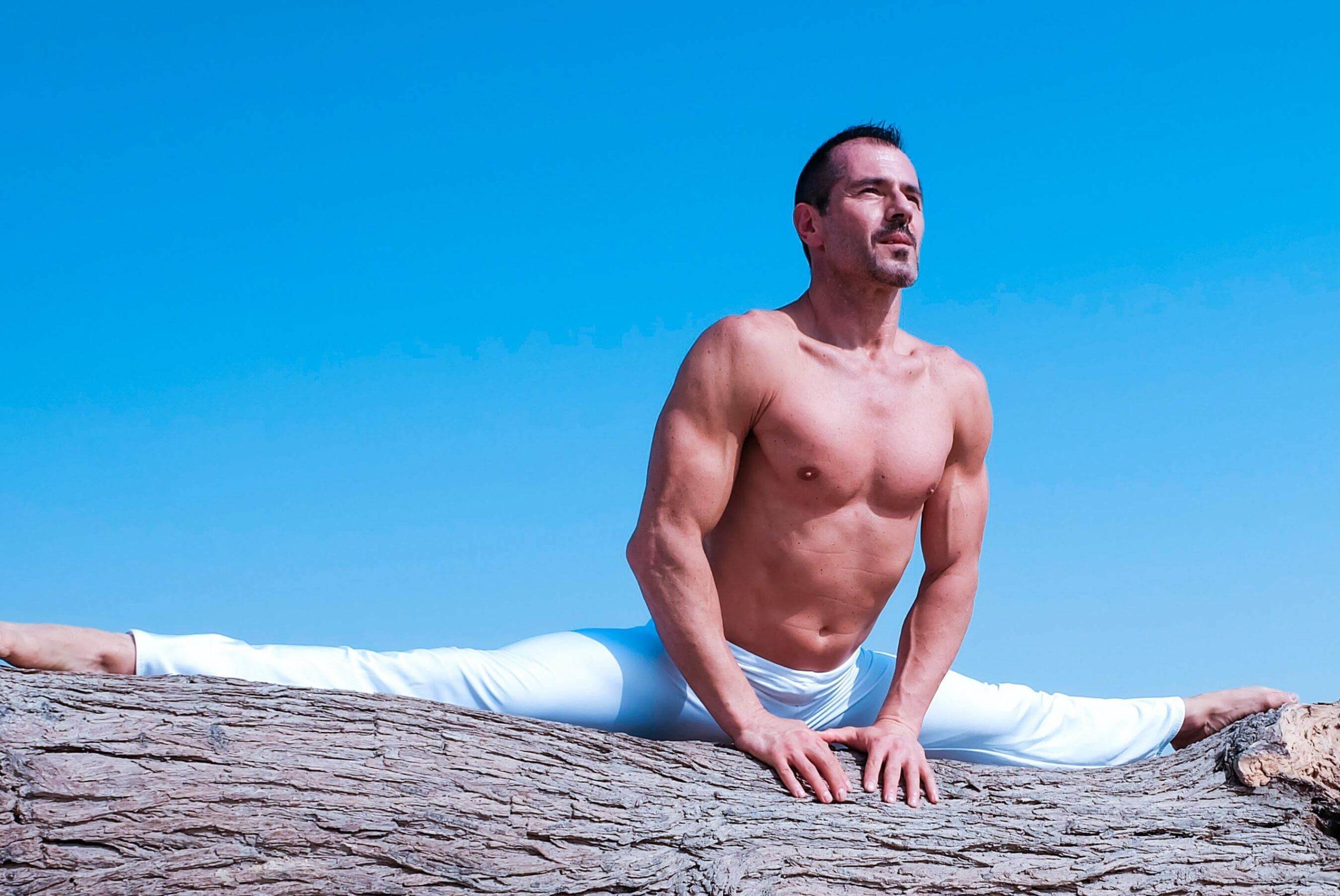 Man Stretching on Log