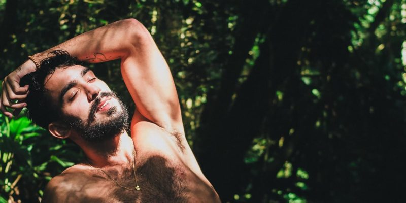 Naked Man Relaxing in the Sun with Testes out of Sight