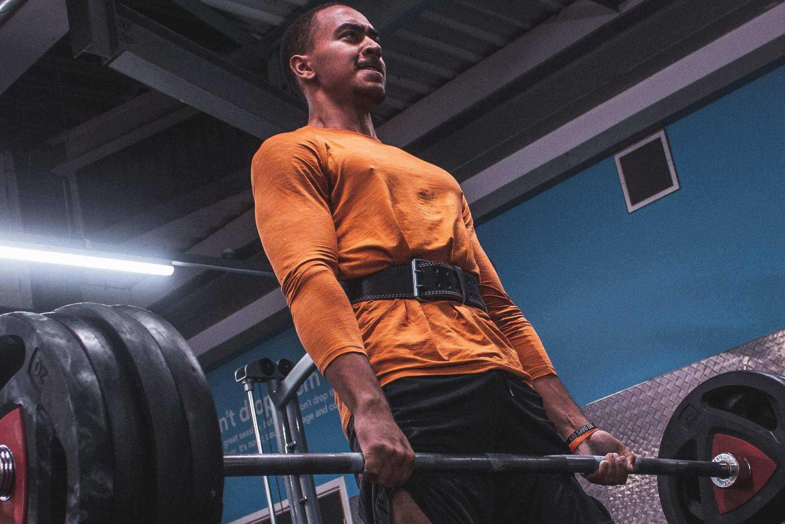 Man Lifting Barbell at Gym