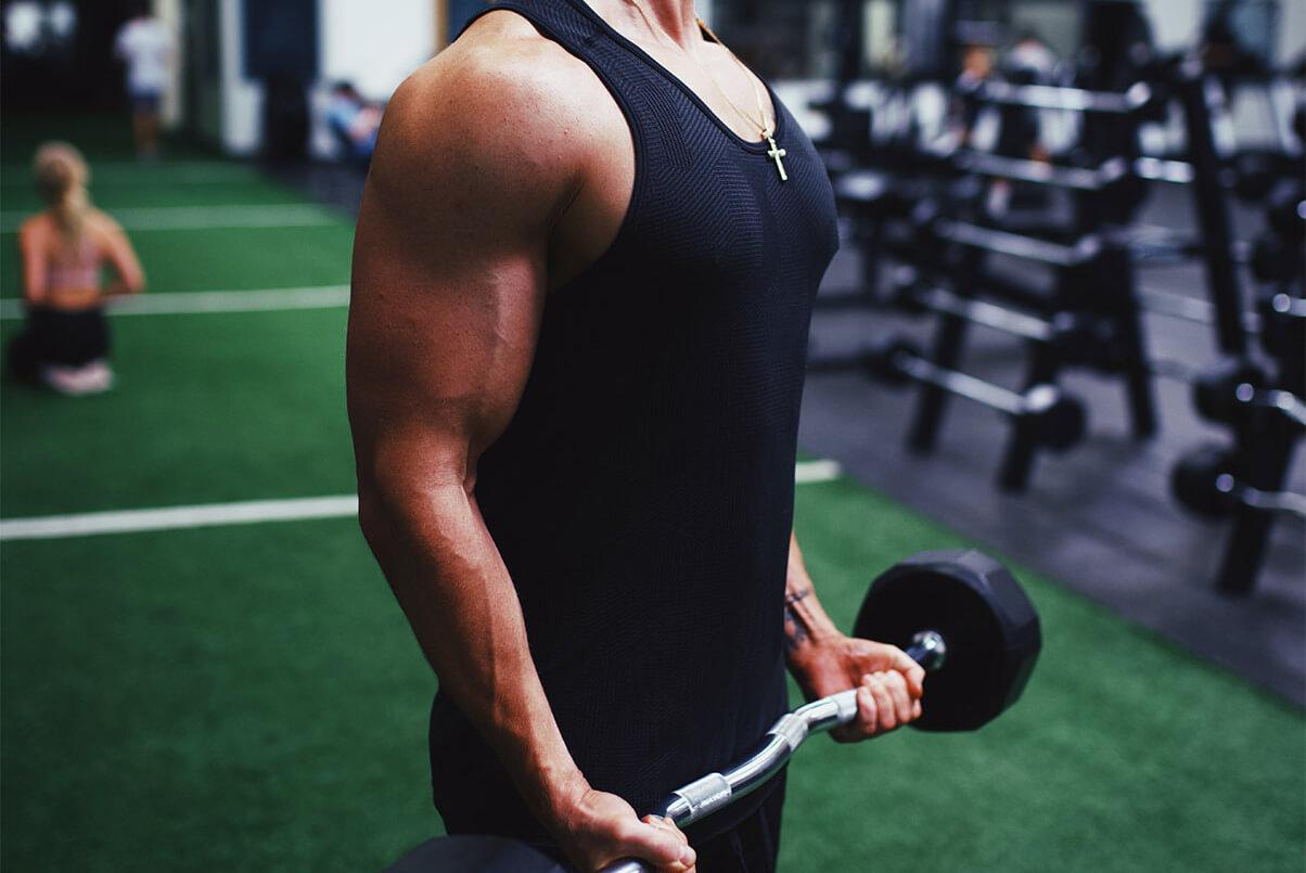Man Doing Bicep Curls at Gym