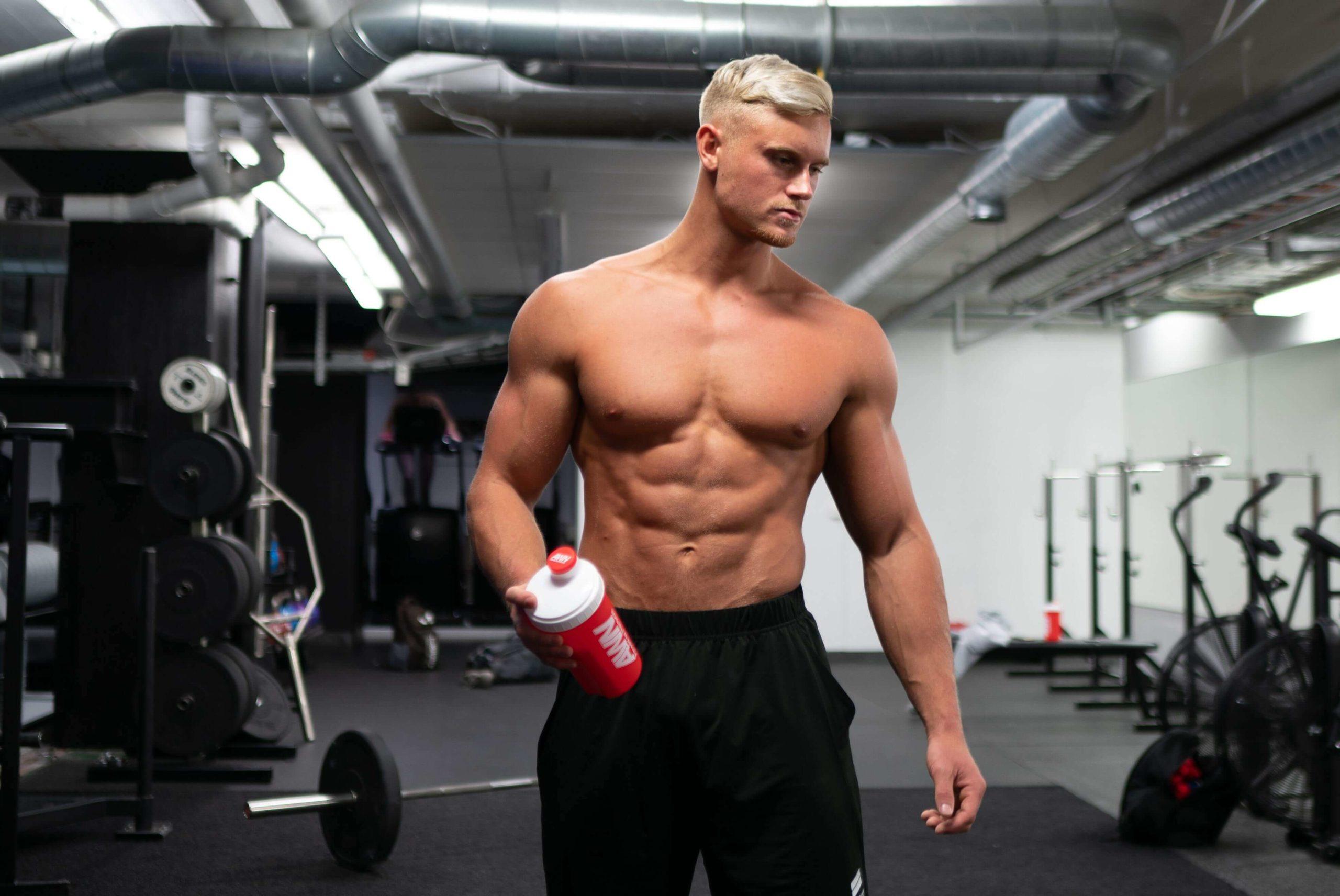 Shirtless Muscular Blonde Man at Gym