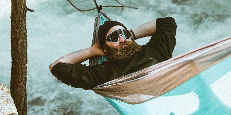Man Resting on Hammock Outside