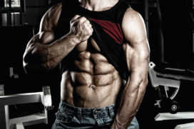Man Lifting up Shirt To Show Abs and Pump