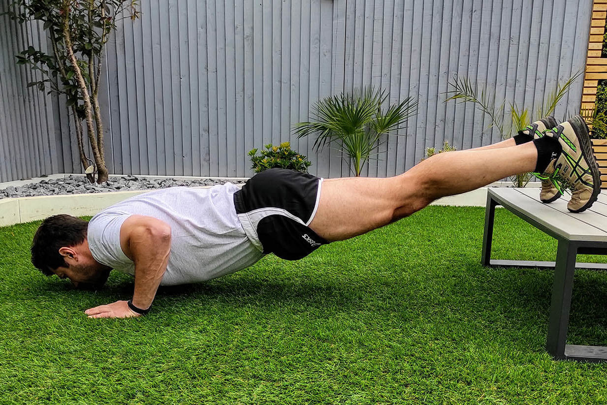 Man Doing Chest Exercises at Home