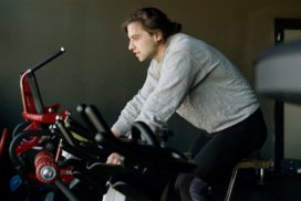 Man on Exercise Bike Doing Cardio