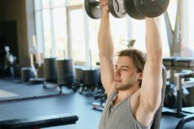 Man Doing Shoulder Presses at Gym