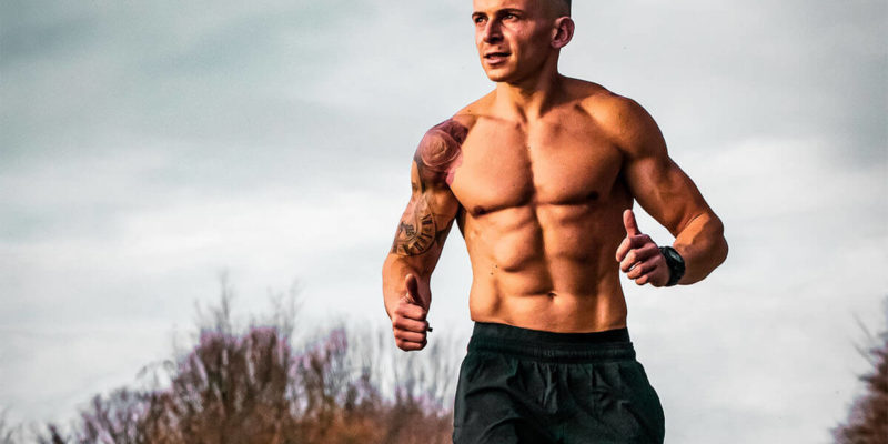Shirtless Man Running Outdoors