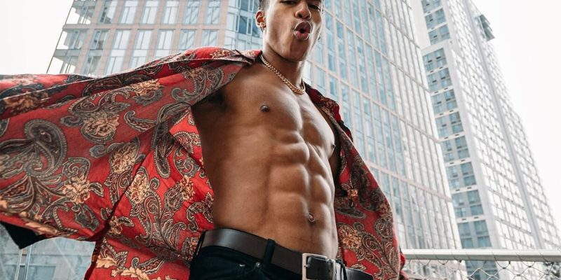 Young Man Showing Off Abs Through Unbuttoned Shirt