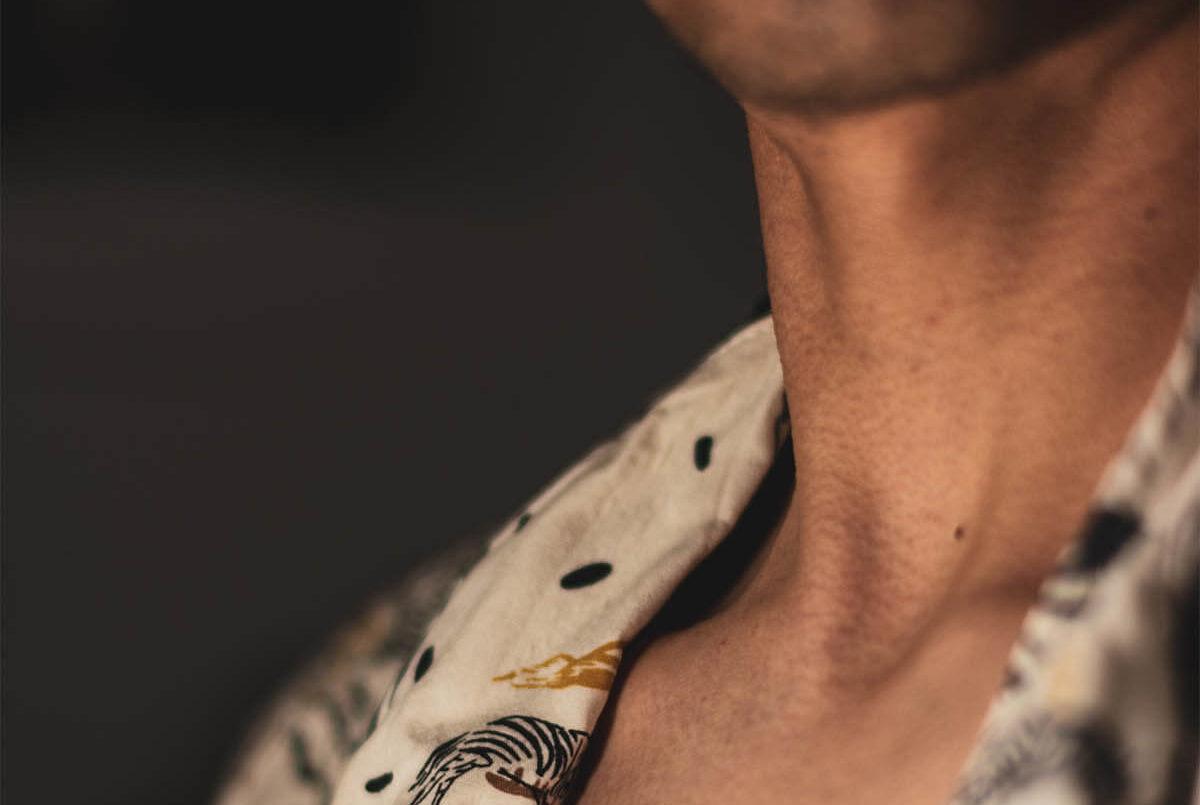 Close Up Photo of Man's Neck