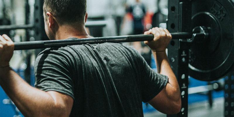 Man at Gym Doing Back Squats