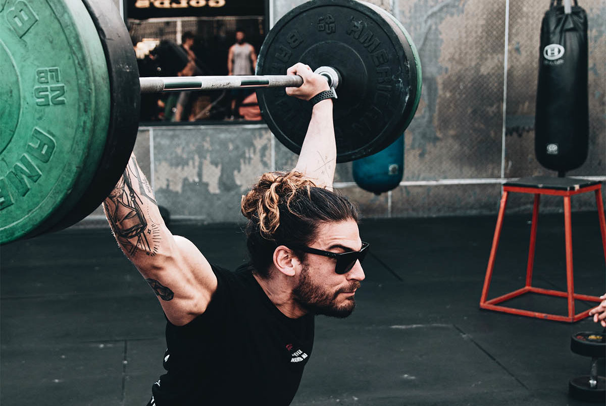 Man Weightlifting with Sunglasses on